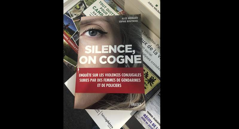 The book Silence, On Cogne is pictured in a book store in Paris, July 30, 2021. In May, Britains Channel 4 released its own investigation on domestic violence by British police, saying more than 125 women reported their officer partners in the last two years. It cited a Freedom of Information request by the Bureau of Investigative Journalism that found that from 2015 to 2018 there were almost 700 reports of domestic violence involving police officers and staff in Britain. In 2019, Sophie Boutboul and Aliz Bernard, a journalist and former victim of domestic abuse by a police officer, co-wrote a book on the subject. (AP Photo/Michel Euler)