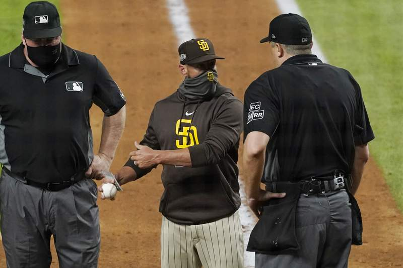 San Diego Padres manager Jayce Tingler, center, argues with home plate umpire Lance Barrett, right, during the sixth inning in Game 1 of a baseball NL Division Series against the Los Angeles Dodgers, Tuesday, Oct. 6, 2020, in Arlington, Texas. (AP Photo/Tony Gutierrez)
