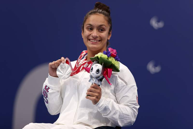 TOKYO, JAPAN - AUGUST 27: (L-R) Silver medalist Ahalya Lettenberger of Team United States poses during the women's 200m individual medley - SM7 medal ceremony on day 3 of the Tokyo 2020 Paralympic Games at Tokyo Aquatics Centre on August 27, 2021 in Tokyo, Japan. (Photo by Dean Mouhtaropoulos/Getty Images)