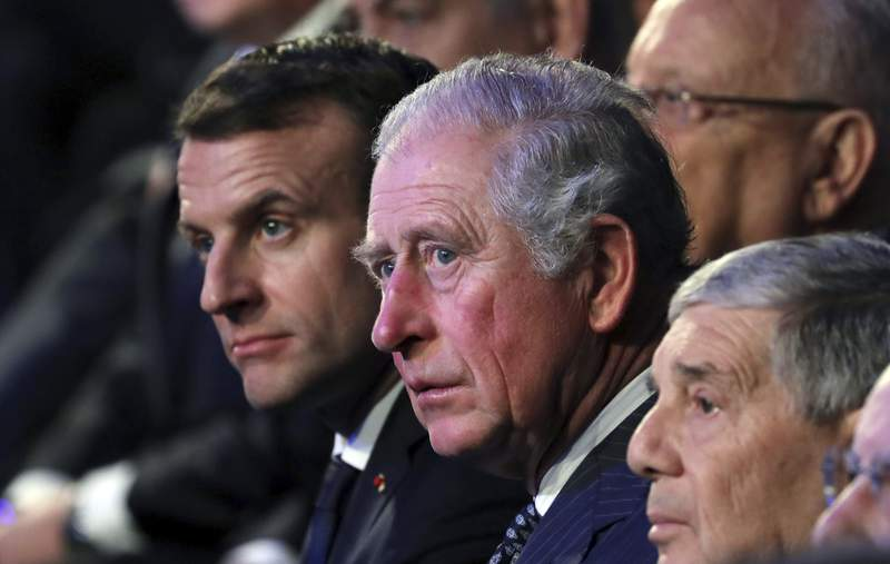 FILE- In this Thursday, Jan 23, 2020 file photo, from left, French President Emmanuel Macron and Britain's Prince Charles attend the World Holocaust Forum at the Yad Vashem Holocaust memorial museum in Jerusalem.  Britains Prince Charles will host French President Emmanuel Macron for a special celebration marking the 80th anniversary of Gen. Charles De Gaulles defiant appeal to the French people to resist the Nazis during World War II. Charles and his wife, the Duchess of Cornwall, will receive Macron at his Clarence House home with a Guard of Honor formed  by Number 7 Company of the Coldstream Guards and accompanied the Band of the Coldstream Guards on Thursday, June 18, 2020. (Abir Sultan/Pool Photo via AP, File)