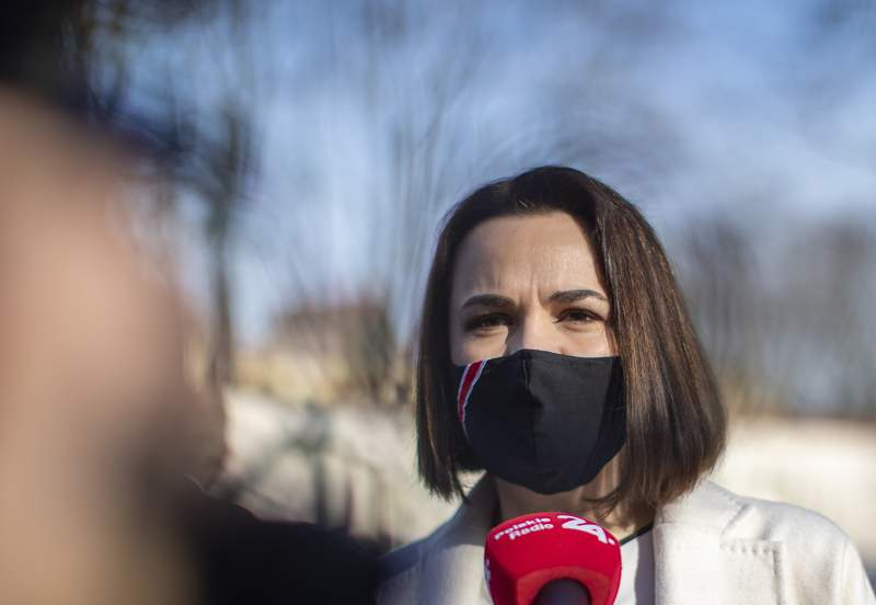 Belarus opposition leader Sviatlana Tsikhanouskaya speaks to the media during the ceremony to commemorate victims of the Chernobyl nuclear disaster at the memorial to Chernobyl workers and firefighters in Vilnius, Lithuania, Wednesday, April 21, 2021. (AP Photo/Mindaugas Kulbis)