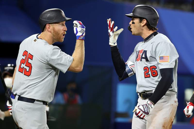 YOKOHAMA, JAPAN - AUGUST 02: Triston Casas #26 of Team United States celebrates with Todd Frazier #25 after hitting a three-run home run in the fifth inning against Team Japan during the knockout stage of men's baseball on day ten of the Tokyo 2020 Olympic Games at Yokohama Baseball Stadium on August 02, 2021 in Yokohama, Kanagawa, Japan. (Photo by Koji Watanabe/Getty Images)