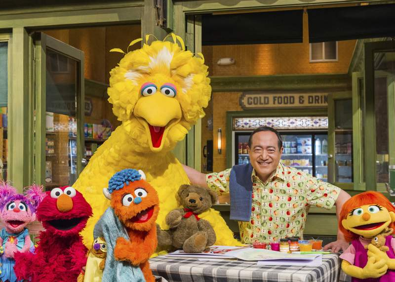 """This image released by HBO shows some of the cast of """"Sesame Street."""" In the wake of the national reckoning on race, """"Sesame Street"""" is going further  teaching children to stand up against racism. Sesame Workshop, the nonprofit, educational organization behind the children's program, will air the half-hour anti-racist special """"The Power of We Special,"""" composed of skits and songs in a Zoom-like format that will stream on HBO Max and the PBS 24/7 streaming channel Oct. 15, and air on PBS Kids the same day. (Sesame Workshop/HBO via AP)"""