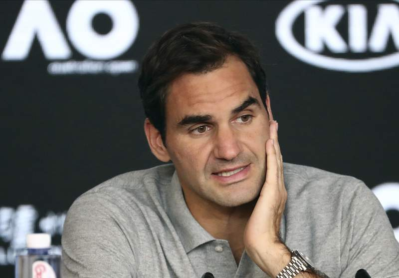 FILE - In this Jan. 30, 2020, file photo, Switzerland's Roger Federer speaks during a press conference following his semifinal loss to Serbia's Novak Djokovic at the Australian Open tennis championship in Melbourne, Australia. Federer leads the annual Forbes ranking of highest-paid athletes with what the magazine says is $106.3 million in total earnings. He is the first tennis player top the list since it was first compiled in 1990. (AP Photo/Dita Alangkara, File)