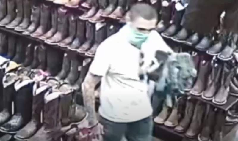 Police are looking for a man responsible for shoplifting turned robbery by force.