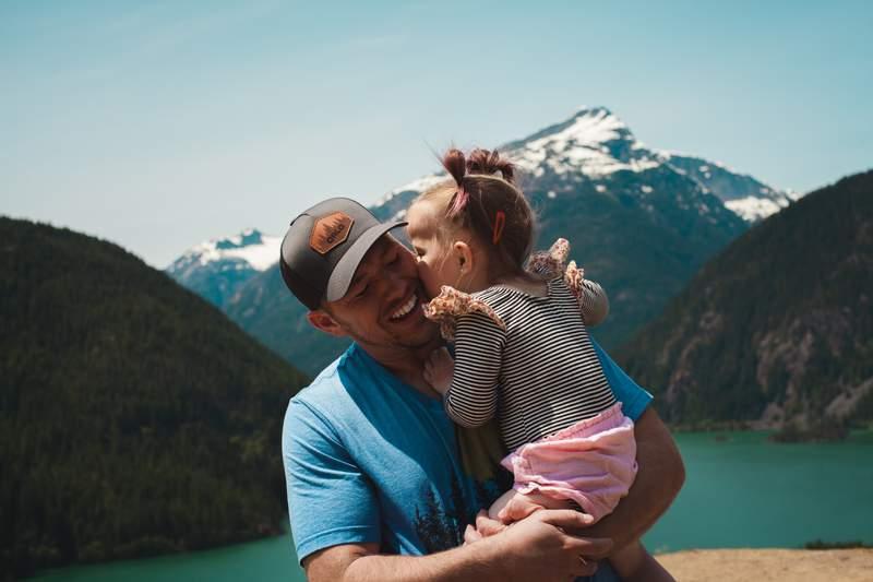 A man holding a girl.