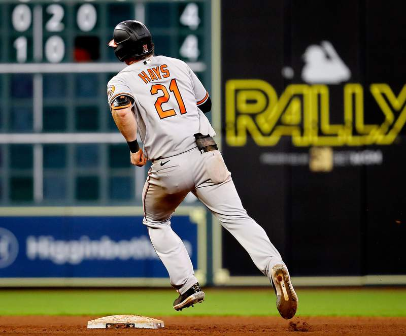 HOUSTON, TEXAS - JUNE 28: Austin Hays #21 of the Baltimore Orioles rounds the bases on his two-run home run in the ninth inning against the Houston Astros at Minute Maid Park on June 28, 2021 in Houston, Texas. (Photo by Bob Levey/Getty Images)