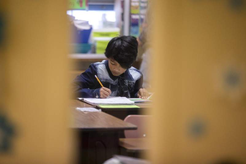 A student in a classroom at Cactus Elementary School. (Credit: Miguel Gutierrez Jr./The Texas Tribune)