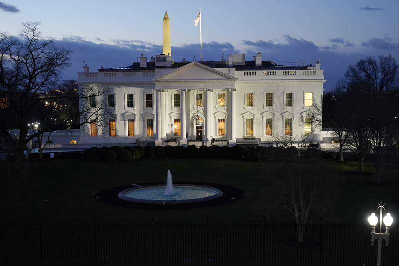 The White House is seen in the early morning before Inauguration Day ceremonies, Wednesday, Jan. 20, 2021, in Washington. (AP Photo/David J. Phillip)
