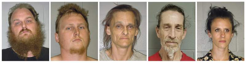 This combination of undated booking photos from the Shenandoah County (Virginia) Sheriff's Office shows from left to right, Donny Salyers, Dennis Salyers, Farrah Salyers, Christopher Sharp and Amanda Salyers. The group are being held without bond and face hate crime and assault charges after an altercation with a black pastor in Edinburg, Va., this month. Shenandoah County Sheriff Timothy Carter has apologized to Pastor Leon K. McCray Sr., who described being arrested after calling 911 on the group who threatened to kill him after trying to dump a refrigerator on his property. (Shenandoah County Sheriff's Office via AP)