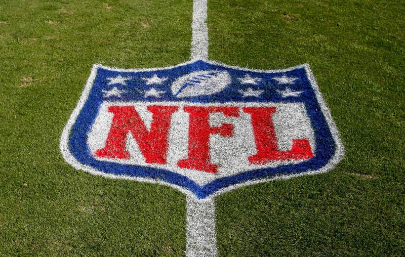FILE - In this Nov. 4, 2018 file photo, the NFL logo is displayed on the field at the Bank of American Stadium before an NFL football game between the Tampa Bay Buccaneers and the Carolina Panthers in Charlotte, N.C. The NFL revealed Sunday, Aug. 23, 2020, that several positive COVID-19 tests were found a day earlier by one of its testing partners, and the Chicago Bears said they had nine false positives. (AP Photo/Nell Redmond, File) (Copyright 2018 The Associated Press. All rights reserved)