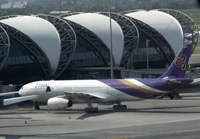 FILE - In this Sept. 14, 2020, file photo, a Thai Airways jet sits on the tarmac at the Suvarnabhumi Airport in Bangkok, Thailand. Creditors of Thai Airways International holding 91.56% of the airlines debt have approved a business reorganization plan, the company announced Wednesday, May 19, 2021 in a filing to the Stock Exchange of Thailand. (AP Photo/Sakchai Lalit, File)