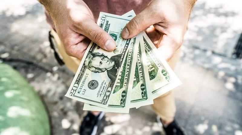 Money in hand.