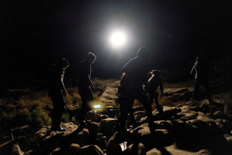 Asylum-seeking migrant families surrendered themselves to the U.S. Border Patrol, after crossing the Rio Grande river into the United States from Mexico, in Roma, Texas, on April 16, 2021.