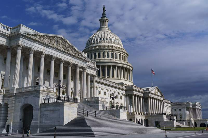 FILE - In this July 1, 2021, file photo shows the Capitol in Washington. Senators negotiating two colossal bills delivering $4 trillion for bolstering infrastructure, health care, environment and other initiatives keep insisting both measures will be fully paid for.  (AP Photo/J. Scott Applewhite, File)