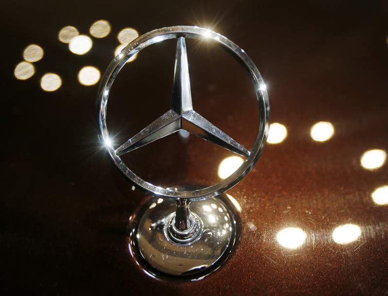 FILE - In this Feb. 5, 2015 file photo the logo of a Mercedes car is photographed during an annual press conference of Daimler AG in Stuttgart, Germany.  (AP Photo/Michael Probst, File)