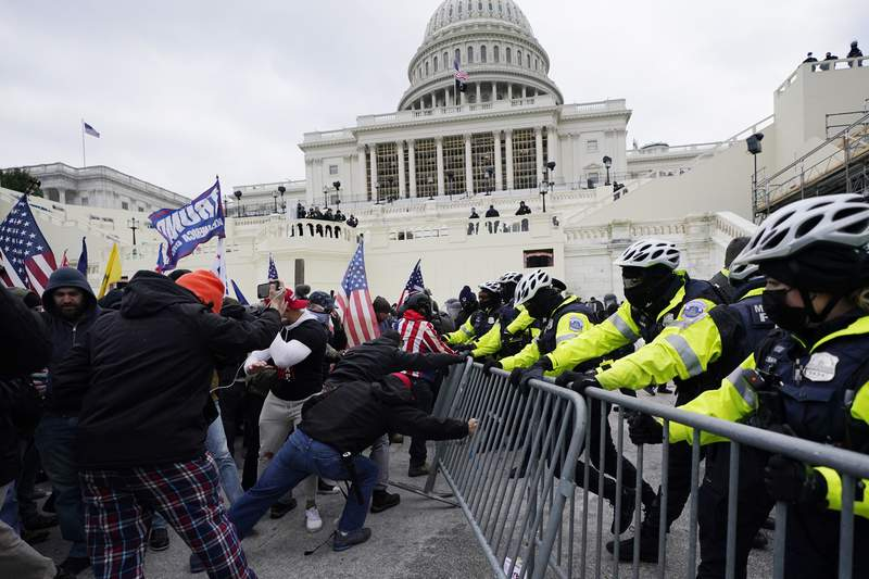 FILE - Trump supporters try to break through a police barrier, Wednesday, Jan. 6, 2021, at the Capitol in Washington. The U.S. Capitol Police said Saturday, Sept. 11 it has recommended disciplinary action in six cases after an internal review of officer behavior stemming from the Jan. 6 attack on the U.S. Capitol. The department's Office of Professional Responsibility opened 38 internal investigations and was able to identify 26 of the officers involved, the police said in a statement. It said in 20 of the cases, no wrongdoing was found. (AP Photo/Julio Cortez, File)