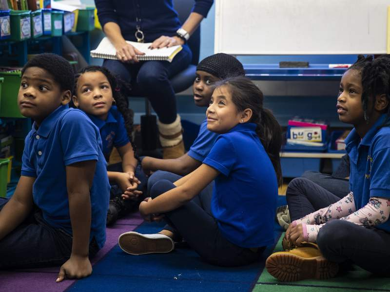 Second grade students at Roswell B. Mason Elementary School on the South Side react to a visit from Mayor Lori Lightfoot on the first day back to class after a Chicago Teachers Union strike closed schools for 11 days, Friday morning, Nov. 1, 2019. (Ashlee Rezin Garcia/Chicago Sun-Times via AP)