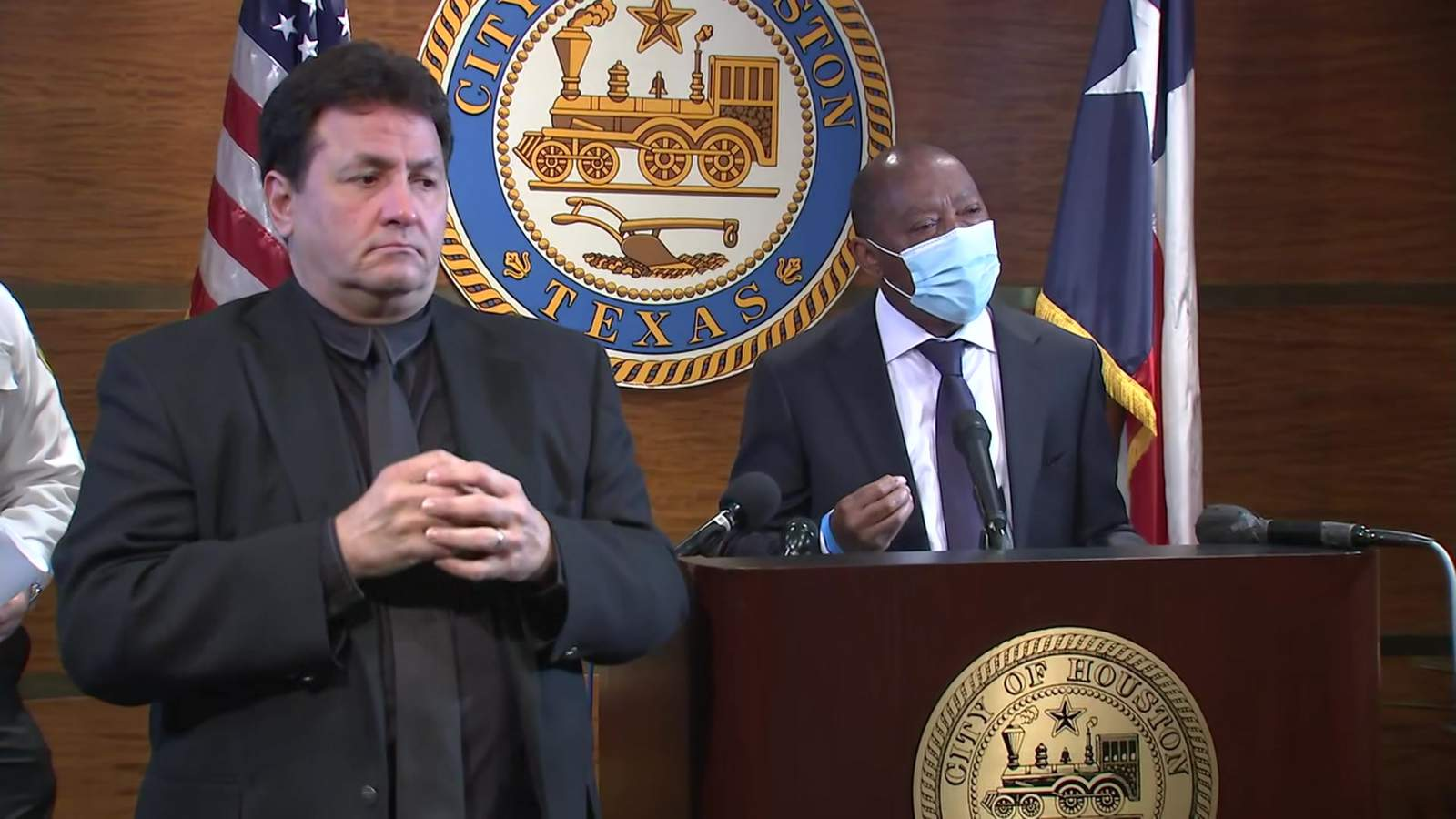 Houston Mayor Sylvester Turner (right) speaks at a news conference at City Hall on March 15, 2021.