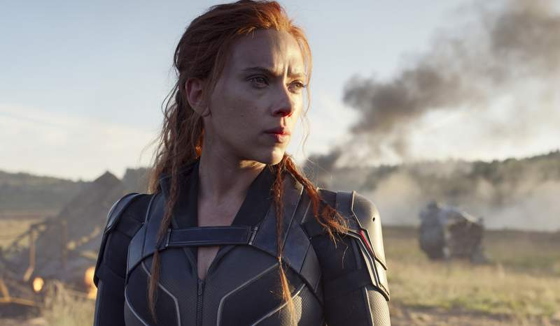 """This image released by Disney/Marvel Studios' shows Scarlett Johansson in a scene from """"Black Widow."""" Disney announced the film release date as July 9, 2021. (Marvel Studios/Disney via AP)"""