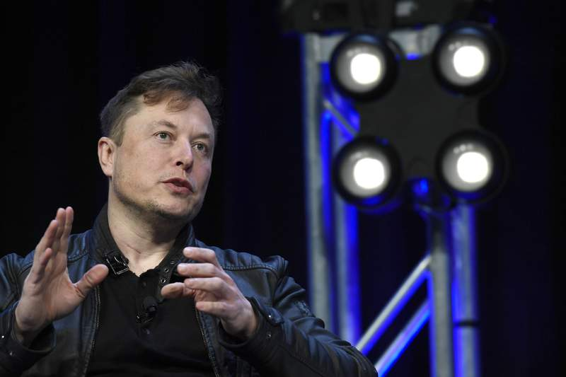 FILE - In this March 9, 2020, file photo, Tesla and SpaceX Chief Executive Officer Elon Musk speaks at the SATELLITE Conference and Exhibition in Washington. Tesla CEO Elon Musk appears to have hit all the milestones necessary to receive a stock award currently worth about $730 million to pad the eccentric billionaire's already vast fortune. The electric car maker ended Wednesday, May 6, 2020, with an average market value of $100.4 billion for the past six months, according to data drawn from FactSet Research. (AP Photo/Susan Walsh, File)