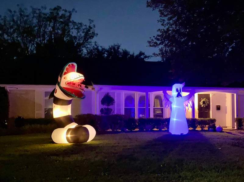 Inflatable decorations in front of this Houston-area home