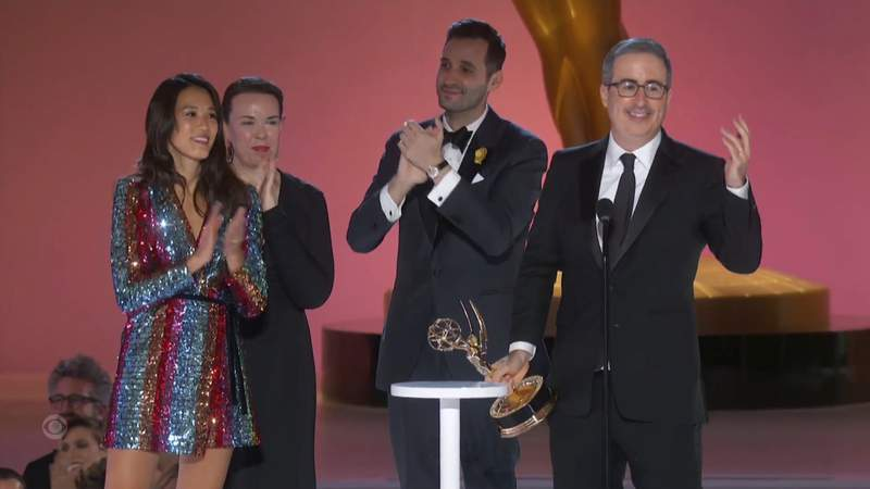 """In this video grab issued Sunday, Sept. 19, 2021, by the Television Academy, John Oliver and crew accept the award for outstanding variety talk series for """"Last Week Tonight with John Oliver""""during the Primetime Emmy Awards. (Television Academy via AP)"""