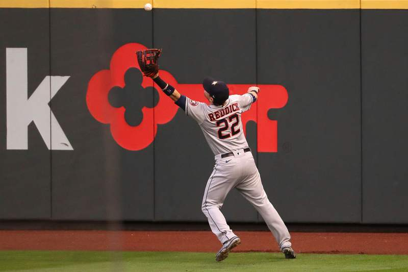 Josh Reddick #22 of the Houston Astros fails to reach a RBI double by Kyle Seager #15 of the Seattle Mariners to take a 1-0 lead in the first inning at T-Mobile Park on September 22, 2020 in Seattle, Washington. (Photo by Abbie Parr/Getty Images)