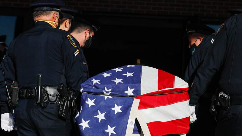 Pallbearers carry the casket containing the body of Houston Police Sgt. Sean Rios into Grace Church Houston on Wednesday, Nov. 18, 2020, in Houston. Rios was fatally shot on Nov. 9 while on his way to work.
