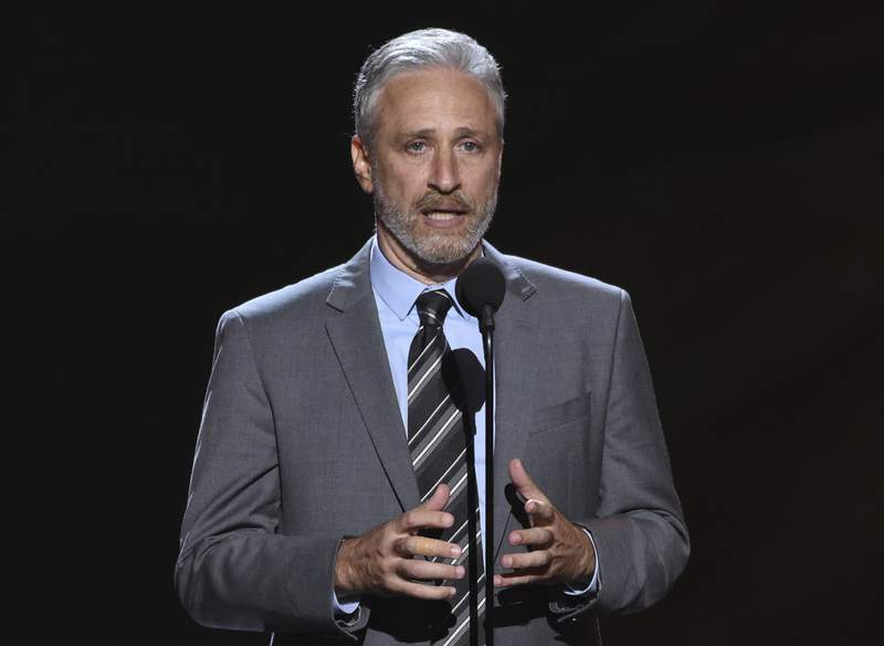 FILE- Jon Stewart presents the Pat Tillman award for service on July 18, 2018, at the ESPY Awards in Los Angeles. Stewart will return to television as host of an Apple TV+ public affairs show, the streaming service said Tuesday, Oct. 27, 2020. (Photo by Phil McCarten/Invision/AP, File)