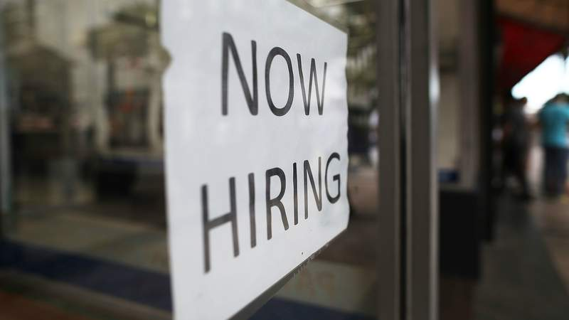 A Now Hiring sign
