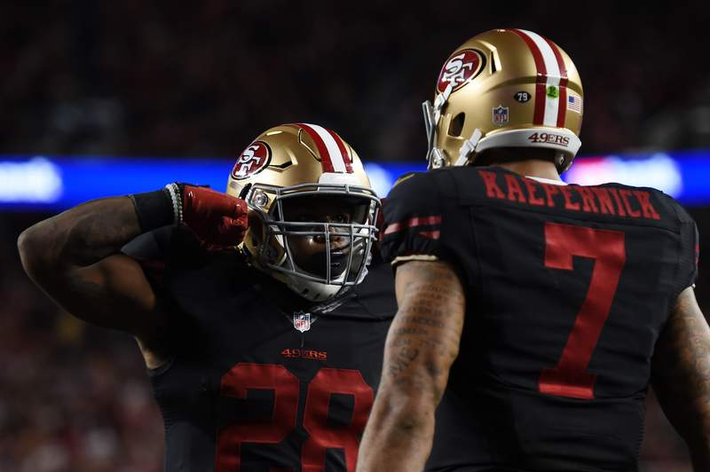 SANTA CLARA, CA - SEPTEMBER 14:  Carlos Hyde #28 of the San Francisco 49ers celebrates with Colin Kaepernick #7 after scoring in the second quarter of their NFL game against the Minnesota Vikings at Levi's Stadium on September 14, 2015 in Santa Clara, California.  (Photo by Thearon W. Henderson/Getty Images)