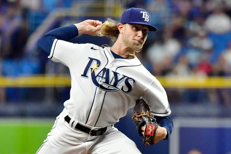 ST PETERSBURG, FLORIDA - SEPTEMBER 20: Shane Baz #11 of the Tampa Bay Rays delivers a pitch to the Toronto Blue Jays in his major league debut in the first inning at Tropicana Field on September 20, 2021 in St Petersburg, Florida. (Photo by Julio Aguilar/Getty Images)