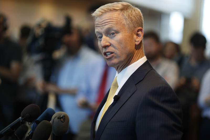 """FILE - In this May 15, 2019, file photo, District Attorney George Brauchler speaks during a news conference in Castle Rock, Colo. An investigation will determine if police officers in suburban Denver will face charges after handcuffing two Black girls and placing them on the ground while mistakenly suspecting they were riding in a stolen car, a prosecutor said Friday, Aug. 7, 2020. Aurora Police Chief Vanessa Wilson and the department are cooperating with the investigation, Brauchler said. He called the public accounts of the confrontation """"very concerning."""" (AP Photo/David Zalubowski, File)"""