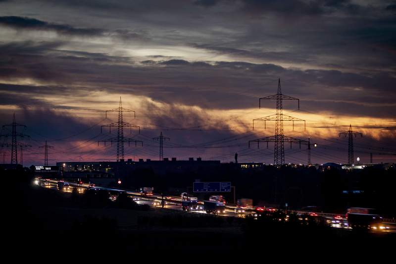Cars and trucks drive on a highway before sunrise in Frankfurt, Germany, Friday, Oct. 2, 2020. (AP Photo/Michael Probst)
