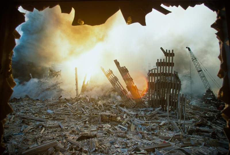 The rubble of the World Trade Center smolders.