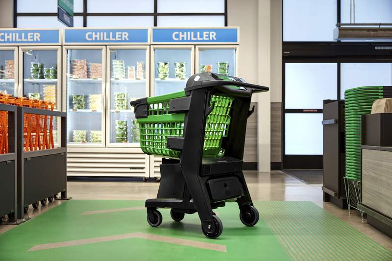 In a photo provided by Amazon,  the company's smart shopping cart is seen in spring 2020 in Los Angeles. The cart, which Amazon unveiled Tuesday, July 14, 2020, uses cameras, sensors and a scale to automatically detect what shoppers drop in. It keeps a tally and then charges their Amazon account when they leave the store. No cashier is needed. (Amazon via AP)
