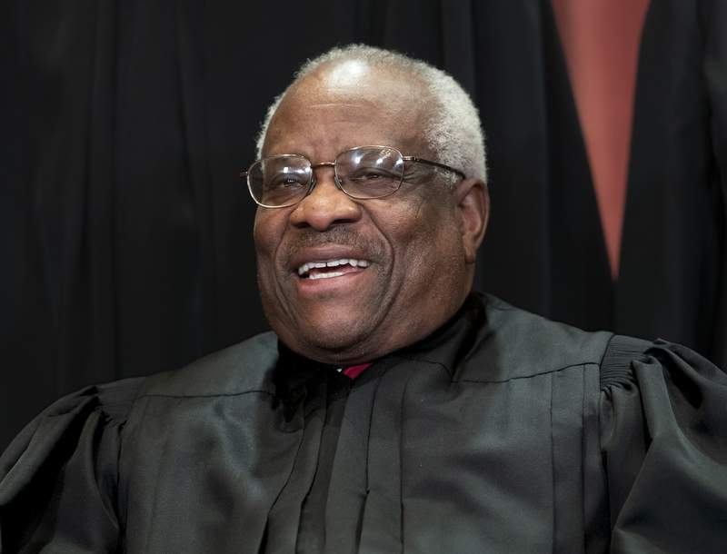 FIILE - In this Nov. 30, 2018, file photo, Supreme Court Associate Justice Clarence Thomas, appointed by President George H. W. Bush, sits with fellow Supreme Court justices for a group portrait at the Supreme Court Building in Washington. Thomas has never been afraid to turn right when his colleagues turn left, or in any direction really as long as theres a place to plug in his 40-foot refitted tour bus. (AP Photo/J. Scott Applewhite, File)