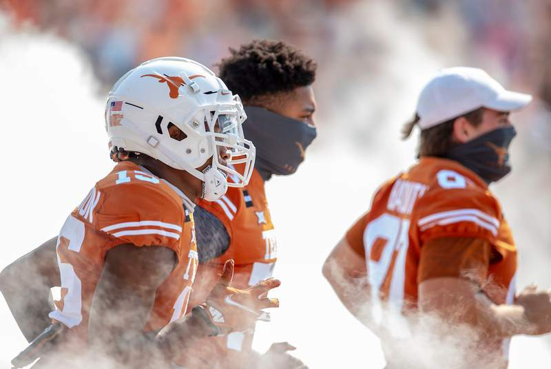 The Texas Longhorns take the field against TCU Horned Frogs in an NCAA college football game at Darrell K Royal-Texas Memorial Stadium on Oct. 3, 2020.