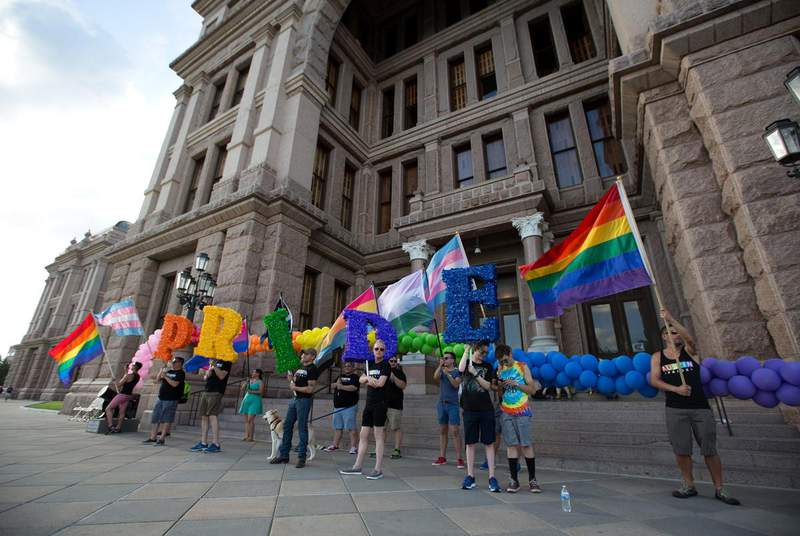 Activists and members of Austin's LGBTQ community gather on the steps of the state Capitol to celebrate the anniversary of the 1969 Stonewall riots on June 28, 2017. (Credit: Austin Price for The Texas Tribune)