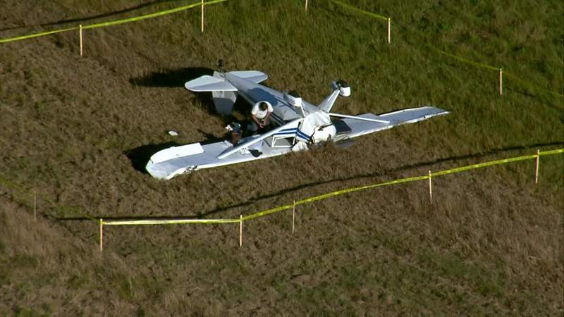 A crashed plane is seen surrounded by caution tape in Manvel, Texas, on Dec. 10, 2020.