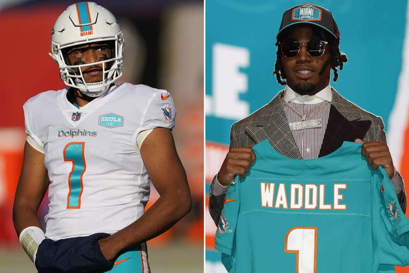 FILE - At left, Miami Dolphins quarterback and former quarterback at Alabama Tua Tagovailoa (1) is shown during an NFL football game against the Denver Broncos in Denver, in a Nov. 22, 2020, file photo. At right, Alabama wide receiver Jaylen Waddle holds a team jersey after being chosen by the Miami Dolphins with the sixth pick at the NFL football draft in Cleveland, in an April 29, 2021, file photo. (AP Photo/File)