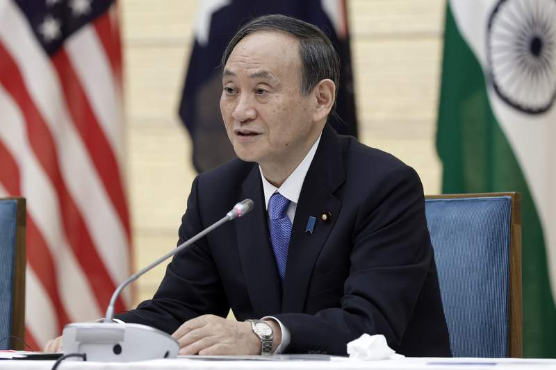 """Japan's Prime Minister Yoshihide Suga speaks during the virtual summit of the leaders of Australia, India, Japan and the U.S., a group known as the Quad"""", at his official residence in Tokyo, Japan, on Friday, March 12, 2021. (Kiyoshi Ota/Pool via AP)"""