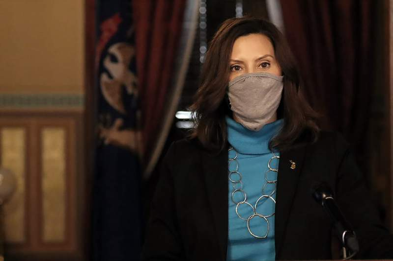 FILE - In this Thursday, Nov. 12, 2020, file photo provided by the Michigan Office of the Governor, Gov. Gretchen Whitmer addresses the state during a speech in Lansing, Mich. Whitmer's office took legal action Friday to force the shutdown of Enbridge's Line 5 pipeline by revoking the easement that allows an underwater section to run through the Straits of Mackinac. (Michigan Office of the Governor via AP, File)
