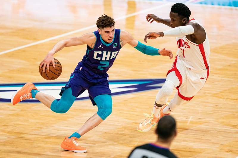 CHARLOTTE, NORTH CAROLINA - FEBRUARY 08: LaMelo Ball #2 of the Charlotte Hornets drives against Victor Oladipo #7 of the Houston Rockets during the third quarter at Spectrum Center on February 08, 2021 in Charlotte, North Carolina. NOTE TO USER: User expressly acknowledges and agrees that, by downloading and or using this photograph, User is consenting to the terms and conditions of the Getty Images License Agreement. (Photo by Jacob Kupferman/Getty Images)