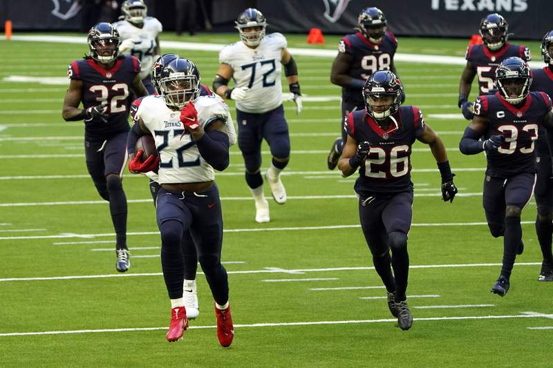 Tennessee Titans running back Derrick Henry (22) runs for a topdown as Houston Texans defends chase him during the first half of an NFL football game Sunday, Jan. 3, 2021, in Houston. (AP Photo/Eric Christian Smith)
