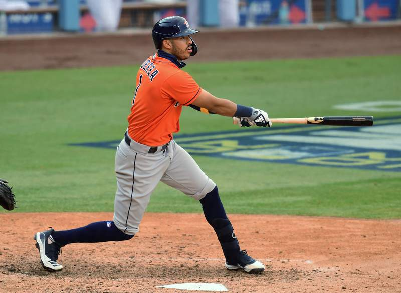 LOS ANGELES, CALIFORNIA - OCTOBER 05:  Carlos Correa #1 of the Houston Astros hits an RBI single against the Oakland Athletics during the ninth inning in Game One of the American League Division Series at Dodger Stadium on October 05, 2020 in Los Angeles, California. (Photo by Harry How/Getty Images)