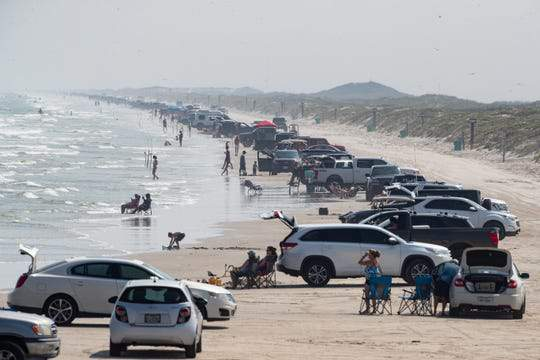 People visit the beach in Corpus Christi near Bob Hall Pier on Wednesday, April 8, 2020.