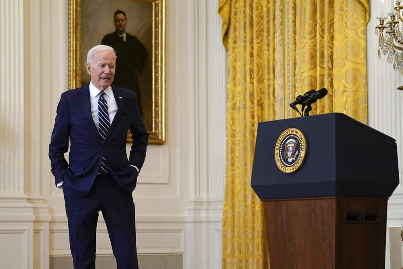 President Joe Biden steps away from the podium as he speaks during a news conference in the East Room of the White House, Thursday, March 25, 2021, in Washington. (AP Photo/Evan Vucci)