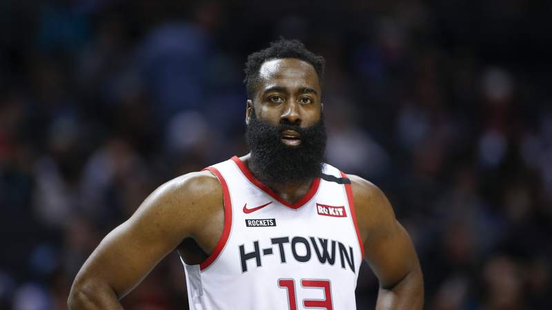 FILE - In this March 7, 2020, file photo, Houston Rockets guard James Harden stands on the court during a break in the action against the Charlotte Hornets during the second half of an NBA basketball game in Charlotte, N.C. This seasons NBA MVP has won the award before. A trio of past winners of the award  reigning MVP Giannis Antetokounmpo of the Milwaukee Bucks, four-time MVP LeBron James of the Los Angeles Lakers and 2017-18 winner James Harden of the Houston Rockets  were announced Saturday, Aug. 8, 2020, as the finalists for this seasons top NBA individual honor. (AP Photo/Nell Redmond, File)